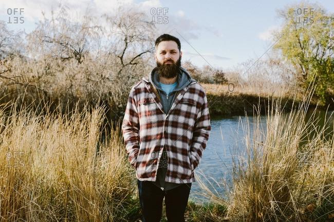Man in flannel in rural setting