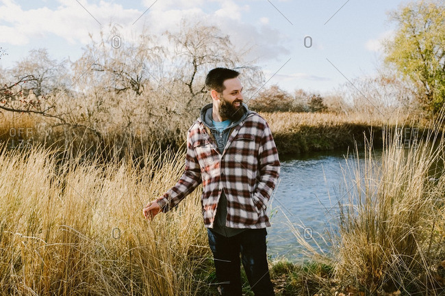 Man in flannel in a rural setting