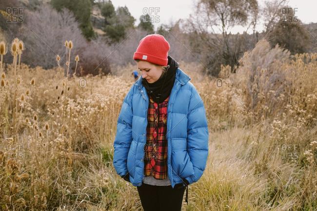 Woman in autumnal mountain field
