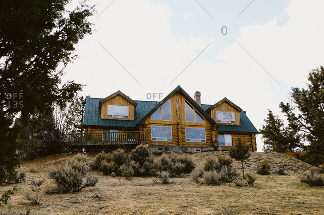 A log cabin on mountain hilltop