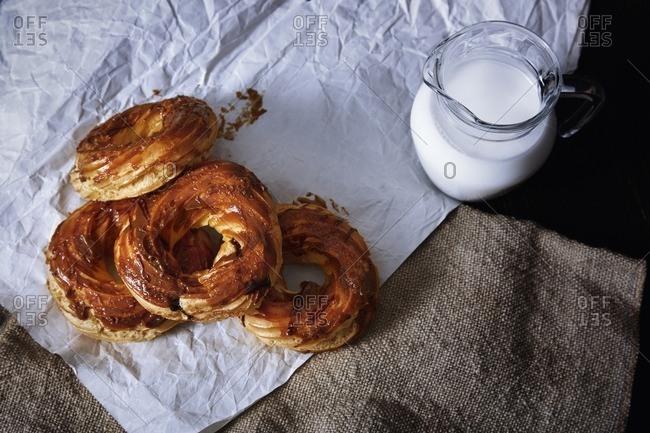 Glazed doughnuts and jug of milk