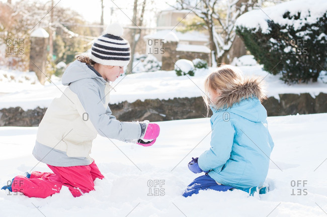 Girls playing together in the snow