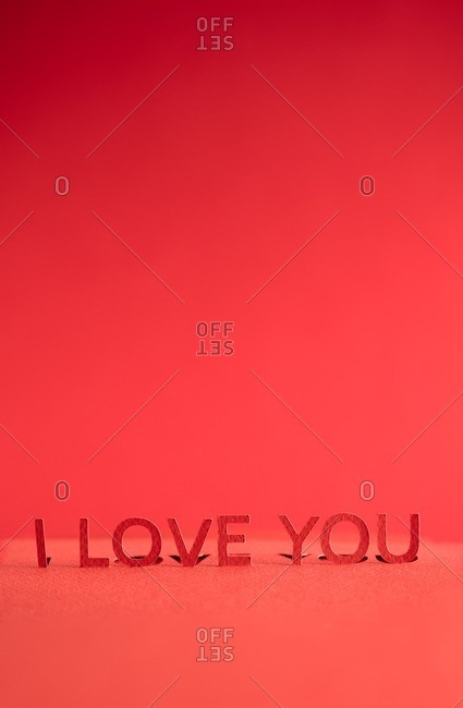 """Red paper cutout reading """"I Love You"""""""