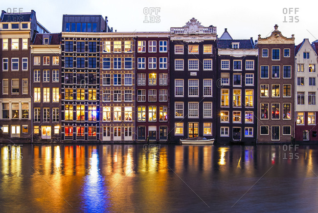Amsterdam, Netherlands - November 9, 2016: Dutch row houses along a canal in Amsterdam
