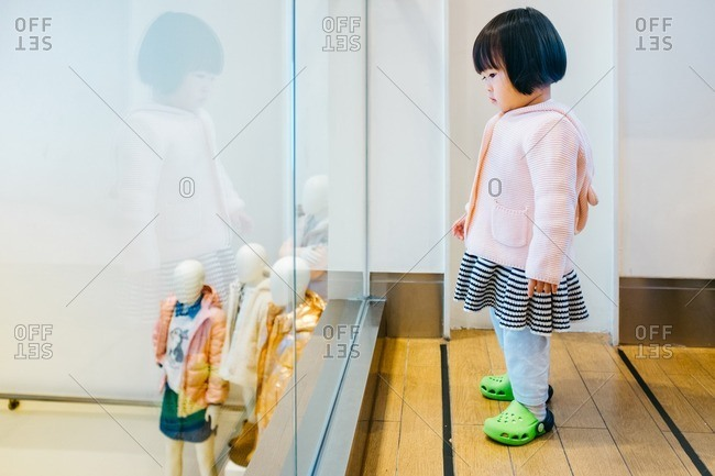 Asian baby girl in a clothing store