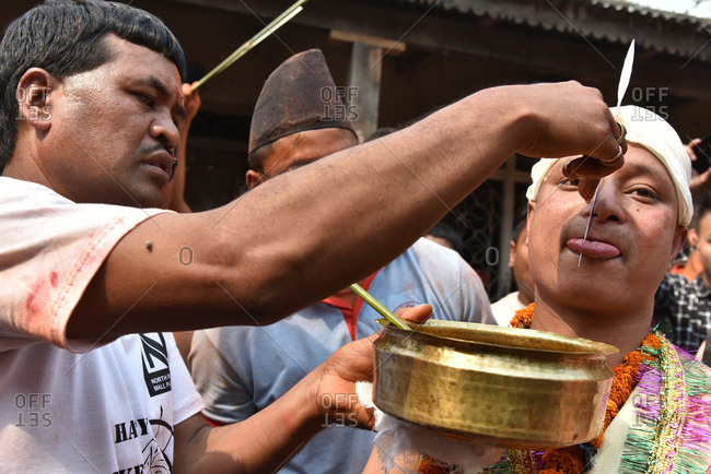 Timi, Nepal - April 14, 2016: Man tasting traditional dish during New Year festival in Nepal