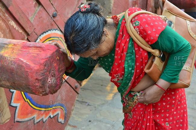 Bakthapur, Nepal - April 13, 2016: Woman praying