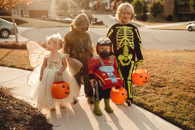 Four children dressed up for Halloween
