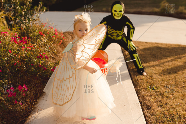 Children dressed as a fairy and skeleton for Halloween