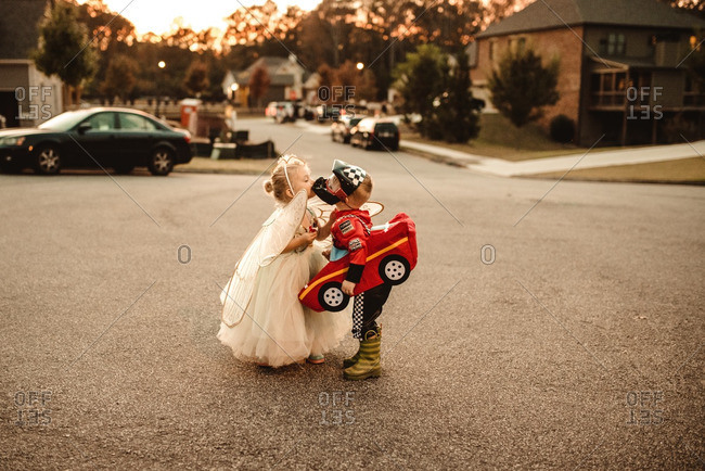Children in Halloween costumes kissing