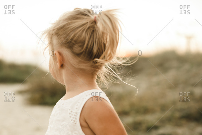 Portrait of a little blonde girl looking away