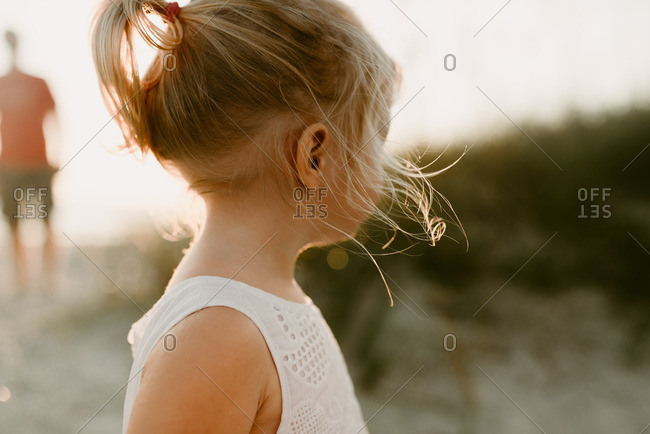 Close up of a little blonde girl looking away