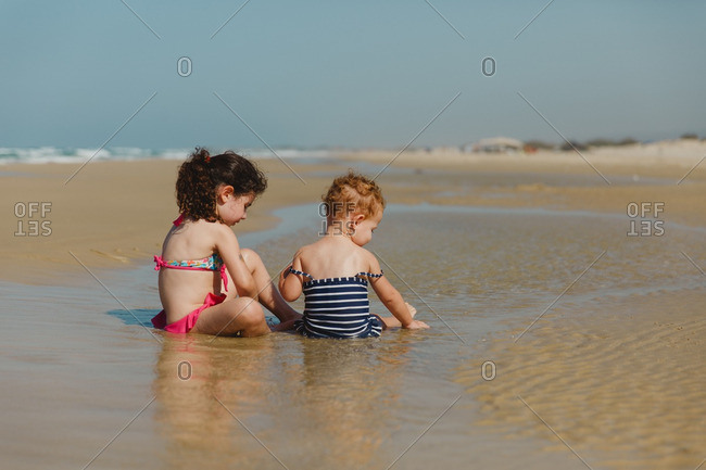 Two girls playing in the tide of the sea in Israel