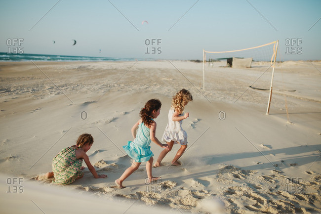 Little girls playing together at the beach