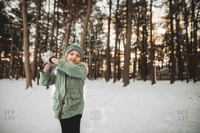 Little girl preparing to throw a snowball