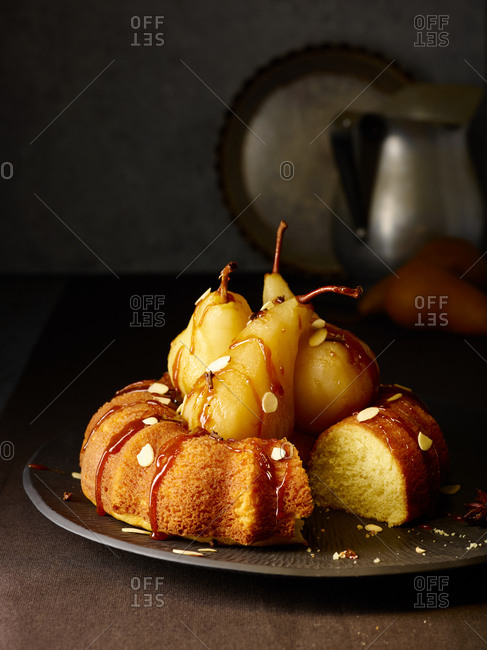 Bundt cake with pears missing a slice