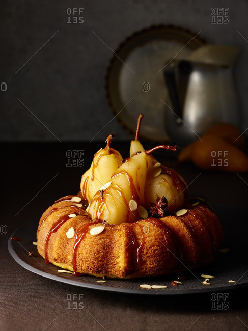 Bundt cake with pears, almonds, caramel and a star anise