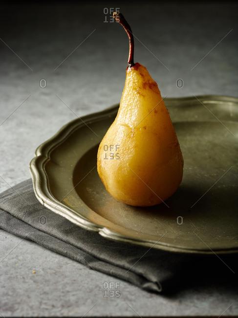 Peeled pear on a plate
