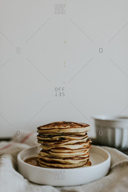 Stack of blueberry pancakes on a plate