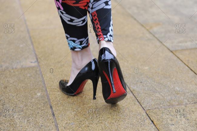 New York, NY - October 10, 2016: Woman wearing black high heels