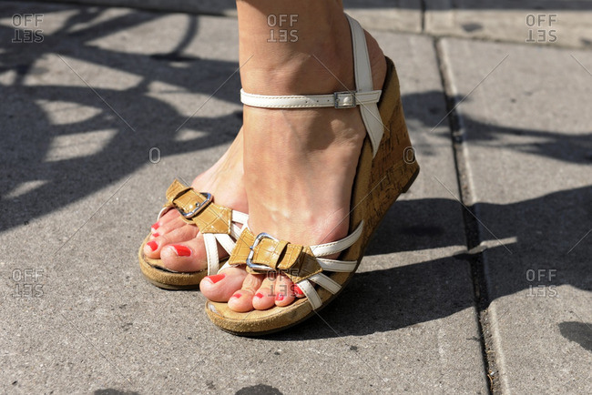 Woman wearing strappy summer wedges