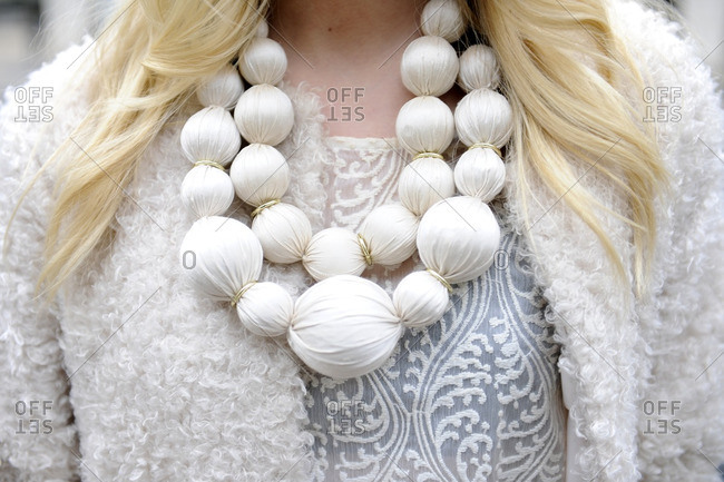 Woman wearing a chunky white bubble necklace