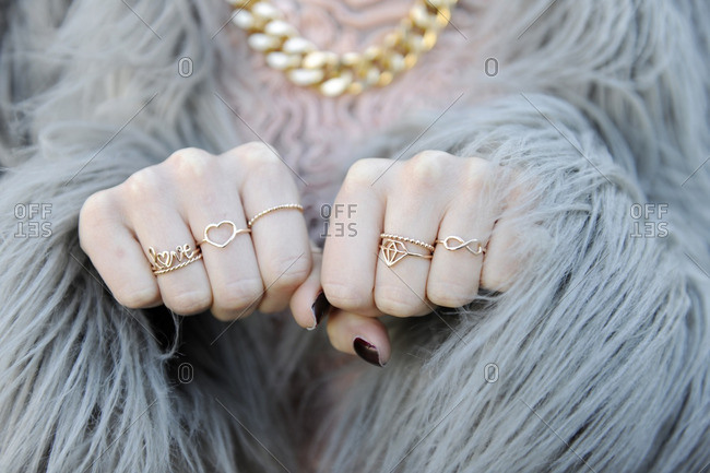 Woman in fur coat with lots of rings