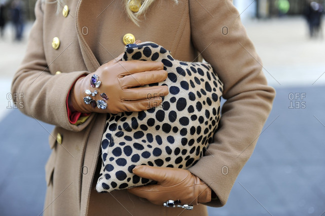 Fashionable woman holding a leopard clutch