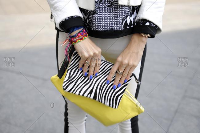 Fashionable woman holding an animal print clutch