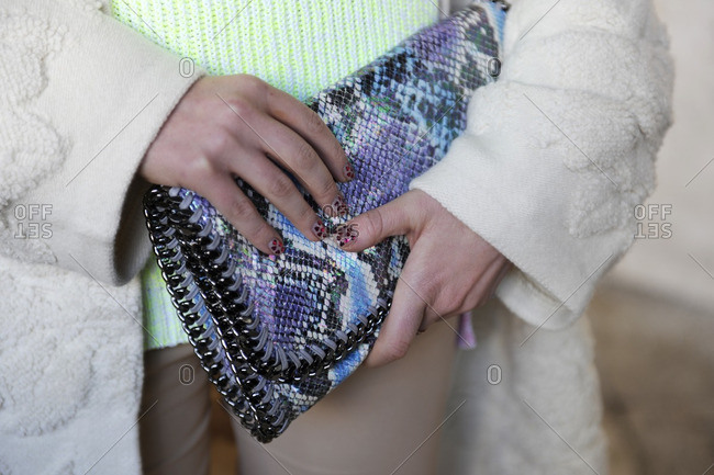 Fashionable woman holding a clutch