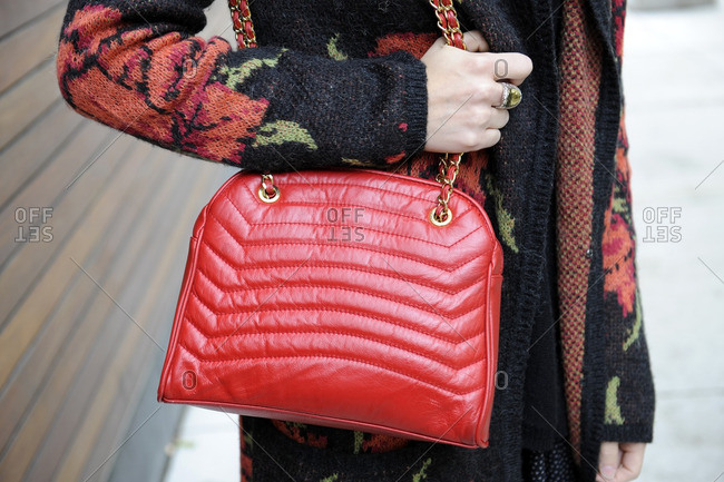 Street style woman with a red purse