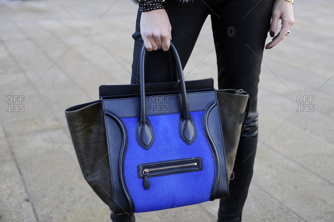 Woman holding blue purse