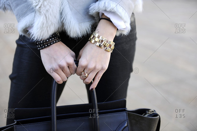 Fashionable woman holding a black purse