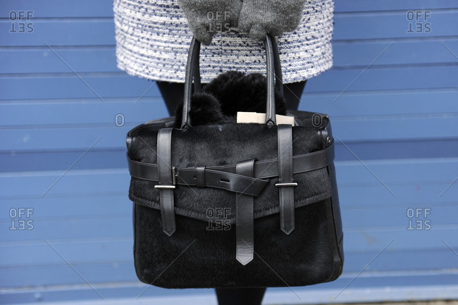 Woman holding a black purse
