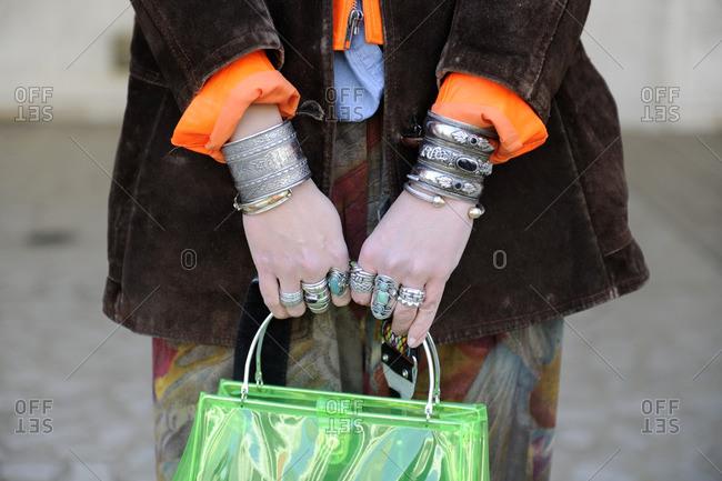 New York, NY - October 10, 2016: Trendy woman holding green purse