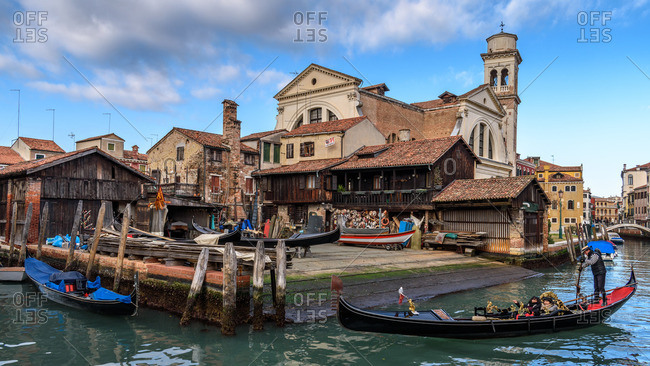 Venice, Italy - December 29, 2016: Gondolas by shores of Grand Canal