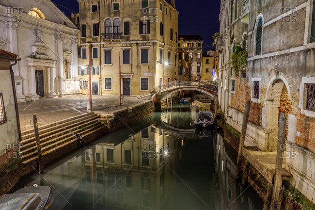 Historic canal in Venice at night
