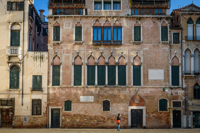 Venice, Italy - December 30, 2016: Person standing in a square