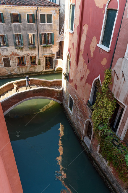 Venice, Italy - December 30, 2016: People on bridge over canal