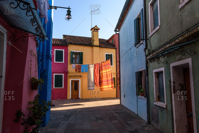 Laundry hanging in street, Burano, Italy