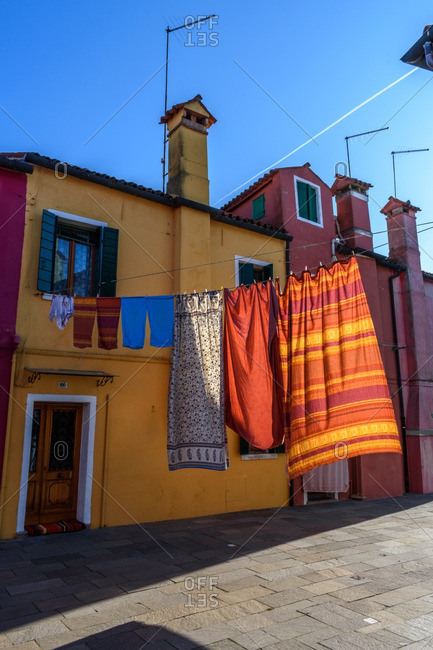 Laundry hanging in a street, Burano, Venice, Italy