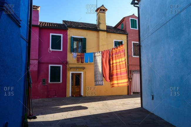 Laundry hanging in a street, Burano, Italy