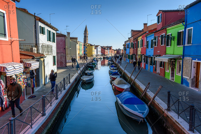 Venice, Italy - December 30, 2016: People walking by residential canal