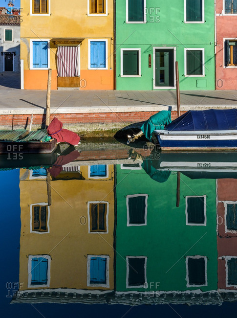 Venice, Italy - December 30, 2016: Houses reflected in canal