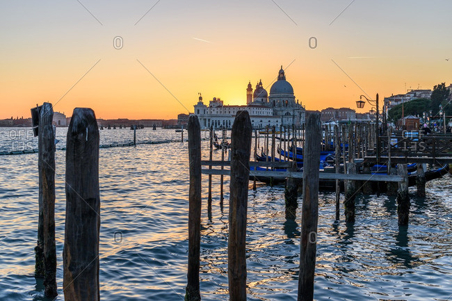Venice, Italy - December 30, 2016: Sunset glowing over Basilica