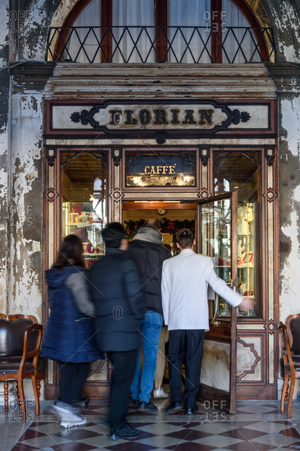 Venice, Italy - December 31, 2016: People entering historic caf_