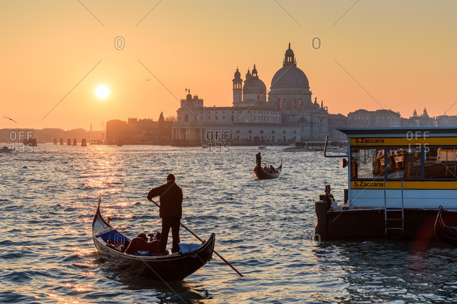 Venice, Italy - December 31, 2016: People in gondolas near basilica