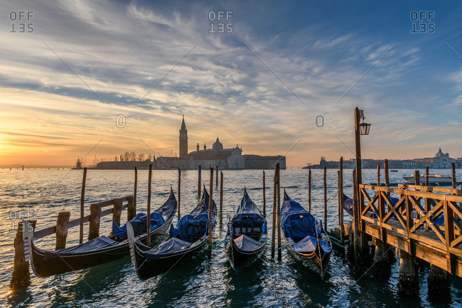 A sunset over shore in Venice
