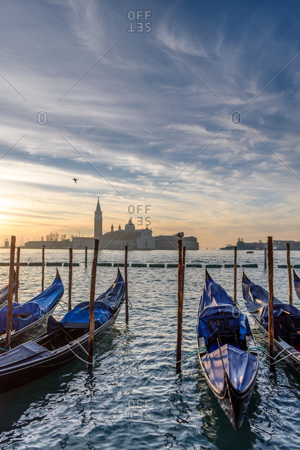 The sunset and gondolas in Venice