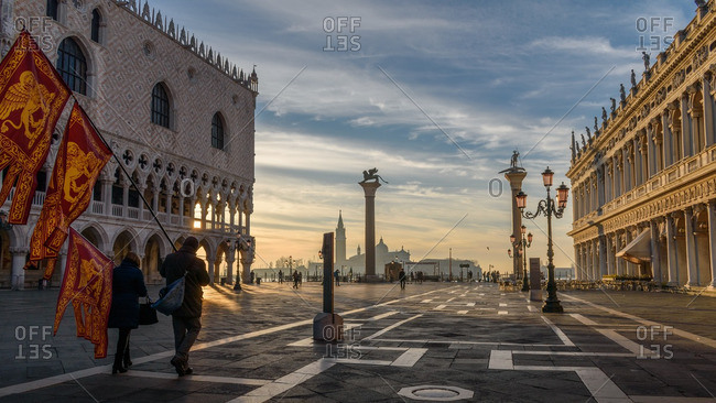 Venice, Italy - January 1, 2017: People with flags in St. Mark's Square